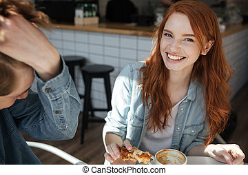 Cheerful girl looking camera in cafe - Cheerful girl looking...