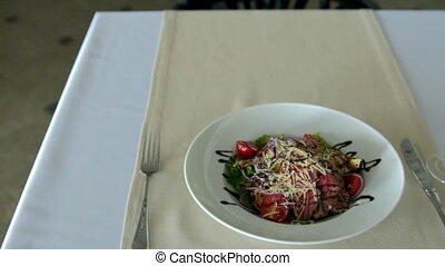 salad is on the table. slow motion - salad is on the table
