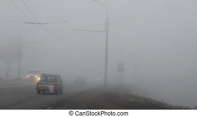 cars moving in the fog