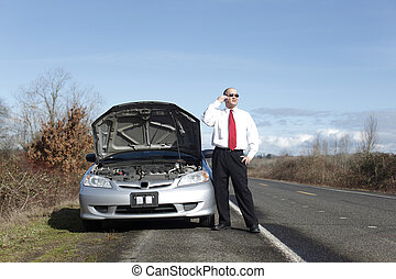 Car trouble - Businessman on cellphone with car trouble