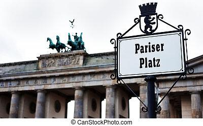 Brandenburg gate with Pariser platz sign by day
