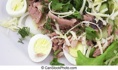 Salad with fish and quail eggs - Rotating salad with cheese,...
