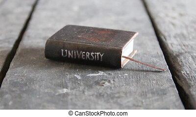 university idea - Vintage book with inscription University