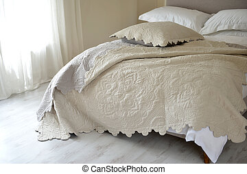 Bedspread - Neutral coloured textured bedspread / throw on a...