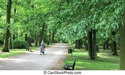 Woman riding on bike in the park