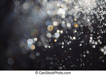 bokeh of water fly and lights on black background, - bokeh...