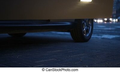 Woman's legs in heels stepping out of car at night - Slender...