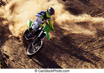 Professional dirt bike rider - Motocross rider creates a...
