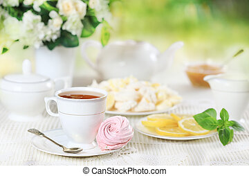 Cup of tea with pink marshmallow and lemon - Cup of hot tea...