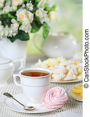 Cup of tea with homemade zephyr - Cup of hot tea with pink...