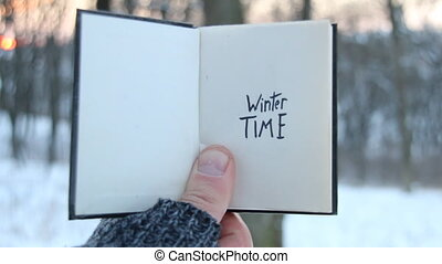 Winter time idea. Book and text. - Winter time . Hand...