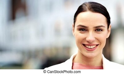 close up of happy smiling young woman outdoors - people,...