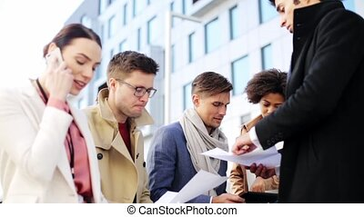 international business team with papers outdoors - business...