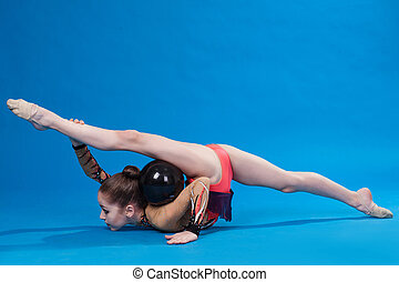 Young caucasian gymnast with a ball