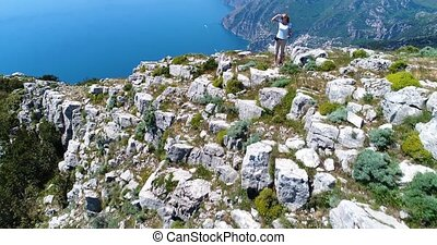 joung woman hiking in mountains above Amalfi coast