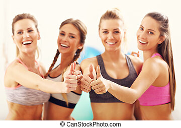 Young women group happy at the gym after workout - Picture...