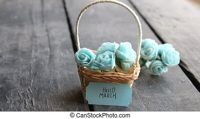 Hello March. Rustic still life, roses and tag - Hello March....