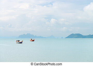 Two lonely fishing boats in a idyllic peacful sea bay - Two...