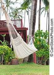 Hammock hung on palm trees for relax vacation - Hammock hung...