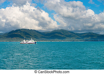 Sea ferry pass near highlands and hilly green island. Samui,...