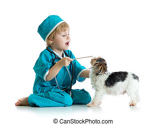 Child weared doctor clothes playing veterinarian with dog -...