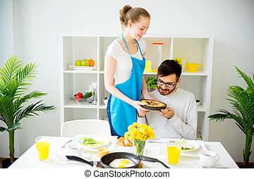 Wife cooking for husband
