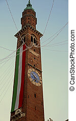 High bell tower with big Italian flag in Vicenza City in...