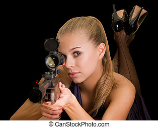 sniper - Beauty blond girl with a gun on a black background