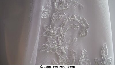 Wedding dress lace closeup pan