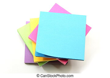 Sticky notes - 5 pads of sticky notes stacked on top of one...