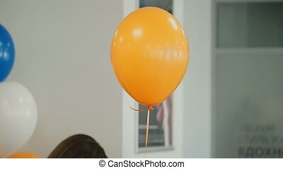 Orange balloon indoors closeup shot