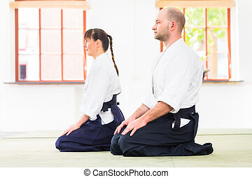 Teacher and student at Aikido martial arts school - Man and...