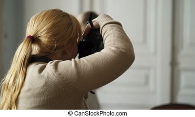 Woman with dslr camera indoors