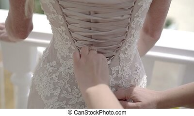 Wearing wedding dress outdoors at sunny day