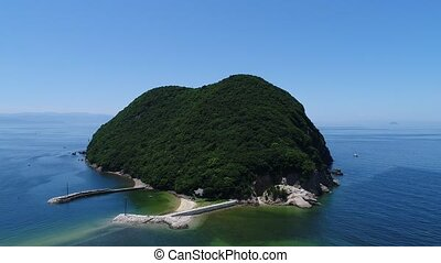 small island of beautiful ocean - aerial drone flying over...