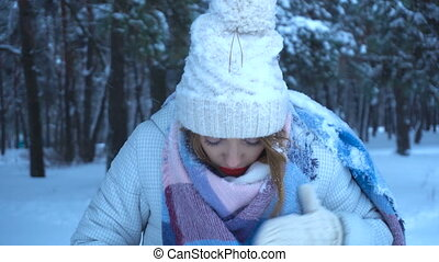 girl with red lips looked snow clothes and smiling -...