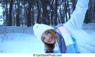 beautiful girl in a warm hat party peeps and laughs -...