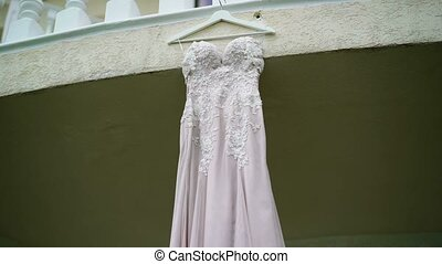 Wedding dress on a balcony shot