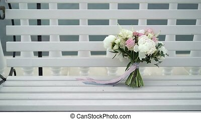 Wedding bouquet on bench outdoors
