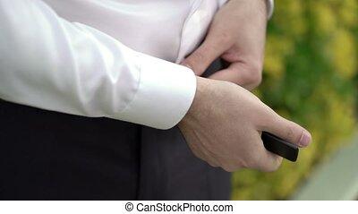Man wearing belt - Man wearing leather belt outdoors