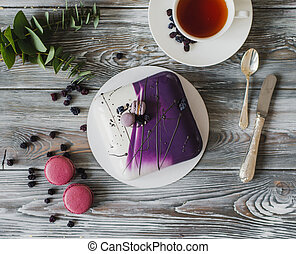 Traditional purple berry cake and macarons souffle dessert...