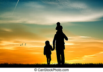 father with sons silhouette at sunset