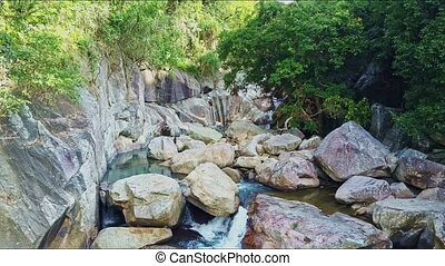 Drone View Mountain River Runs among Boulders and Trees -...