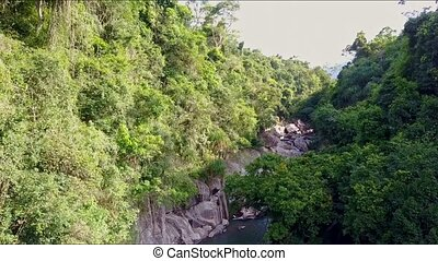 Drone Flies Over Canyon with Trees Cliffs and River - drone...