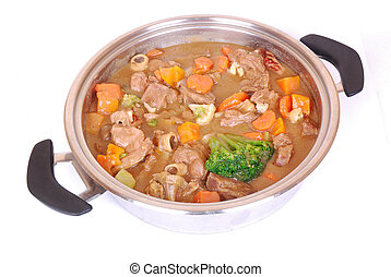 Veal stew - A big silver pot with freshly cooked South...