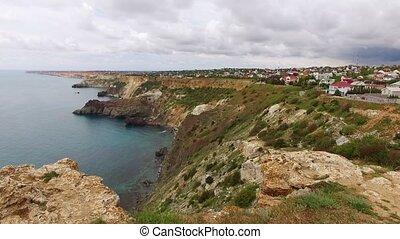 Rocky coast on Black sea at sunny day aerial
