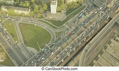 Aerial shot of heavy traffic jam and moving train in the...