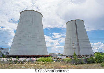 Power station cooling towers against cloudy sky on a summer...