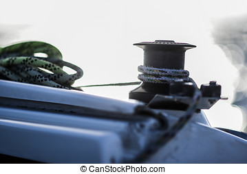 Capstan with line on a sailboat with white background.