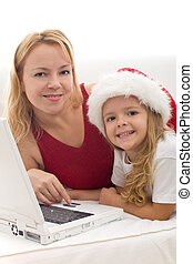 Woman and little girl searching for christmas present online